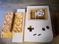 Usinage de panneaux pour la fabrication de Game Boy table sur notre CNC